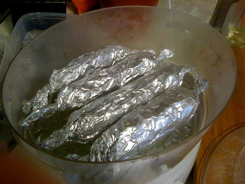 Steaming links of seitan in foil