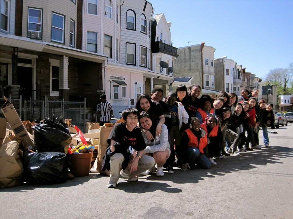 The St. John's University volunteers with kids and block residents
