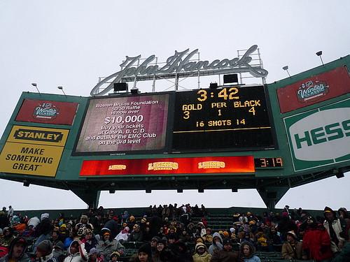 Under the electronic scoreboard