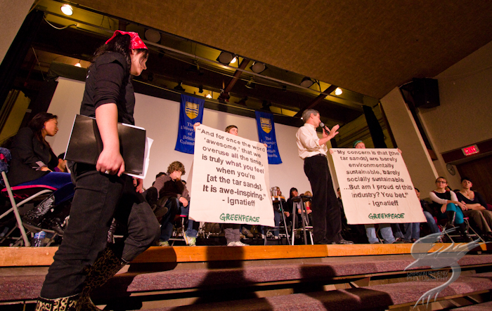 Greenpeace protesters disrupt town hall