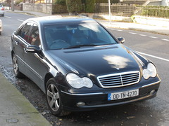 Black Mercedes Benz C-Class Limousine with mer...