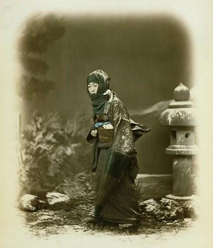 woman in winter dress by Felice Beato