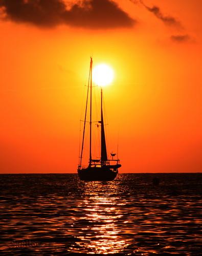Sail Boat Anchored at Sunset