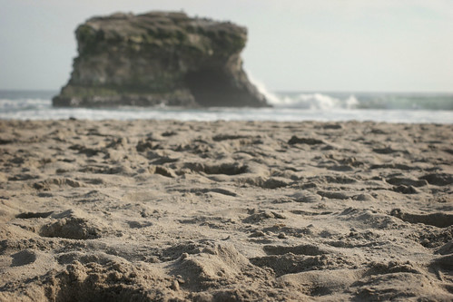Lying in the sand at Natural Bridges