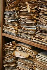 stacks of newspapers, stacks of files