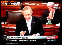 Dodd prays for the 60th vote while Reid speaks...