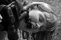 The Spigot of The News is Always Flowing, water spigot, news spigot, girl drinking water, water from a fountain, water fountain,