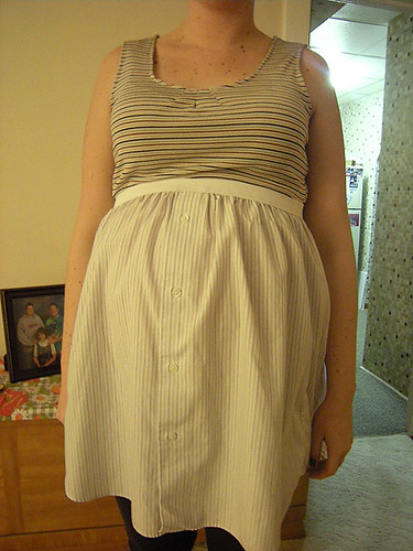 The dress, covering the baby bump, or baby shelf.