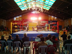 The make-shift wrestling ring, with ropes wrapped in fraying electrical tape and a thin greying mattress on the floor