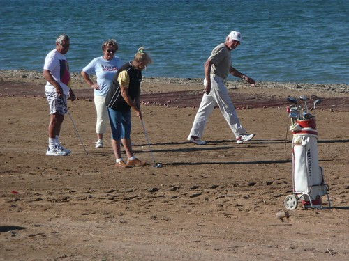 Jugando al Golf en la playa