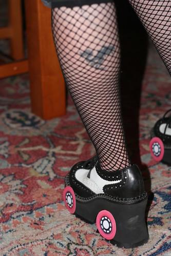 closeup on leg of halloween costume of roller derby grrrl