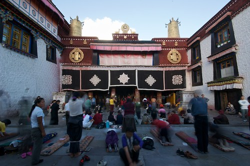 Prostrating and praying in front of the Jokhang in Lhasa, Tibet