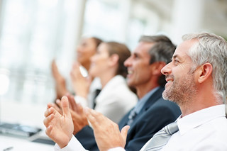 Group of happy business people clapping their ...