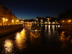 View toward City Hall (Hotel de Ville) from Pont Saint-Louis with river cruise ship MS Renoir of Strasbourg heading under the bridge