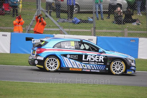 Aiden Moffat celebrates after race one at the British Touring Car Championship 2017 at Donington Park