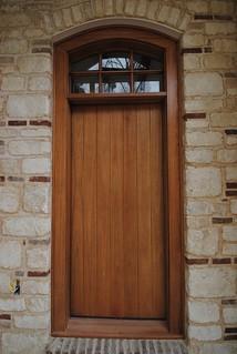 8 ft tall slab door with true divided light window.
