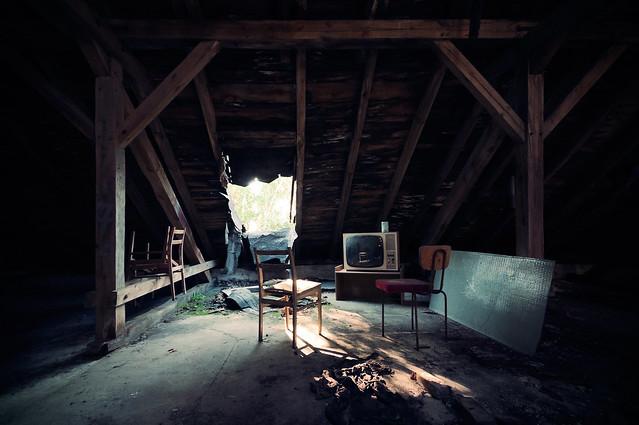 watching tv in the attic
