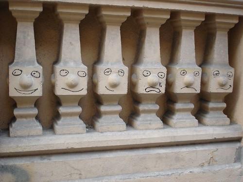 Graffiti in Madrid - faces on pillars