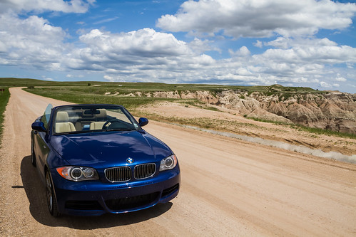 Badlands and BMW 135 Convertible sunny day by chris favero