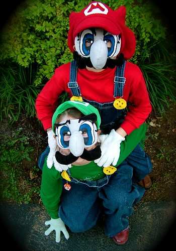 Photograph of two children in Mario and Luigi costumes.