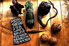 metal and thread and painted gourds,leather balls and iron knocker