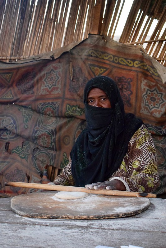 Bedouin woman baking