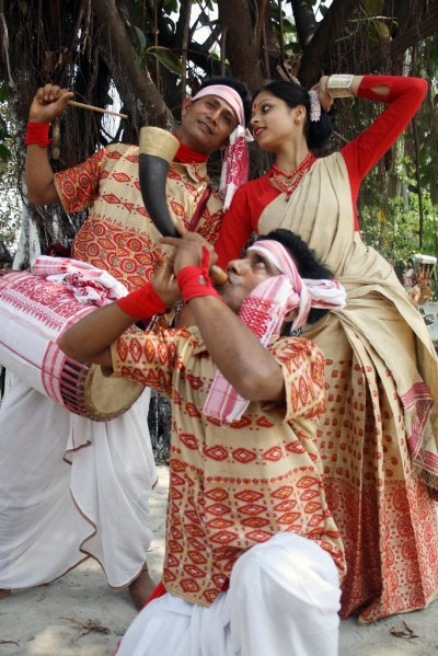 BIHU DANCE UNDER A TREE IN NAGAON,ASSAM,INDIA.