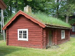Traditional red wooden house with green grass roof, Sweden