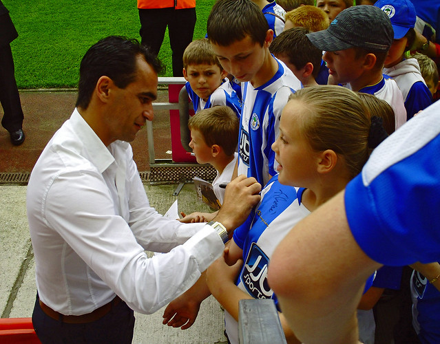 Roberto Martinez signs a fan's shirt, Wigan Athletic v St. Mirren 8th August 2009
