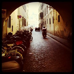 Mopeds on a cobblestone street in Florence, Italy