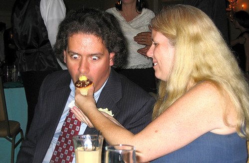 20090912 - Britt & Chris's wedding - reception - Clint, Carolyn - funny cupcake face - (by Dad)