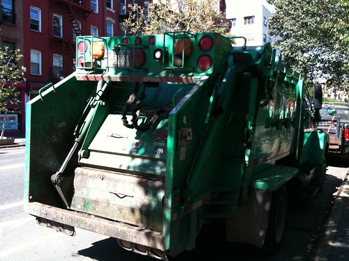 A tiny little garbage truck