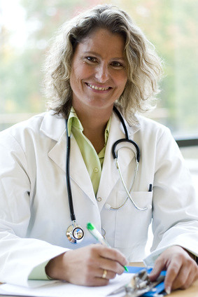 female medical professional writing