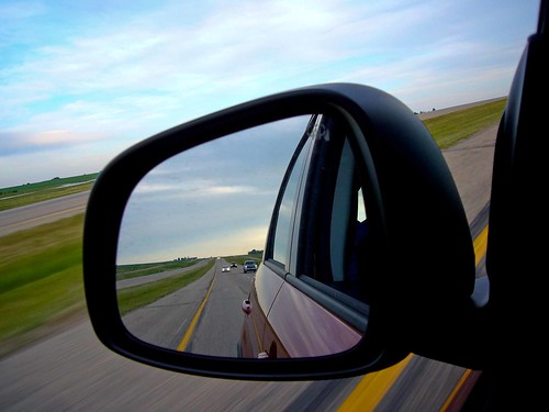 Highway 2 from a rearview mirror