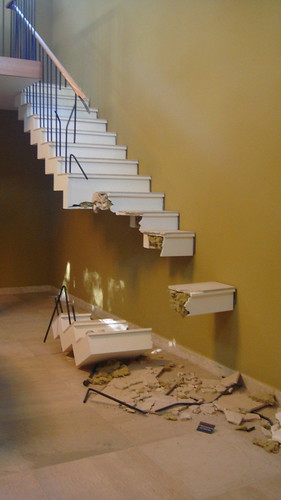 A Picture of a Stair with more than a few stairs missing.