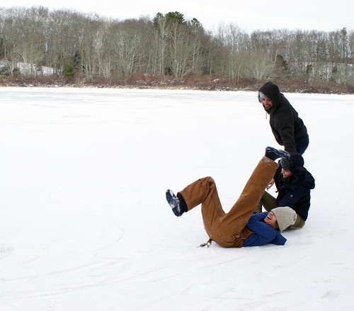 Friends tumble on the frozen pond