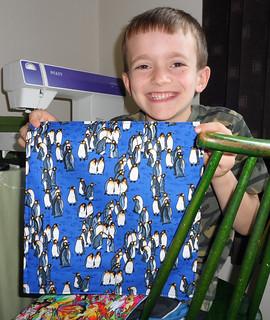 rafe shows off penguin napkin
