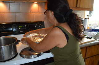Mom then adds her own untraditional ingredient of coconut milk to make everything moist and ultra-tasty before wrapping the ti-leaves over the top and covering tightly with foil