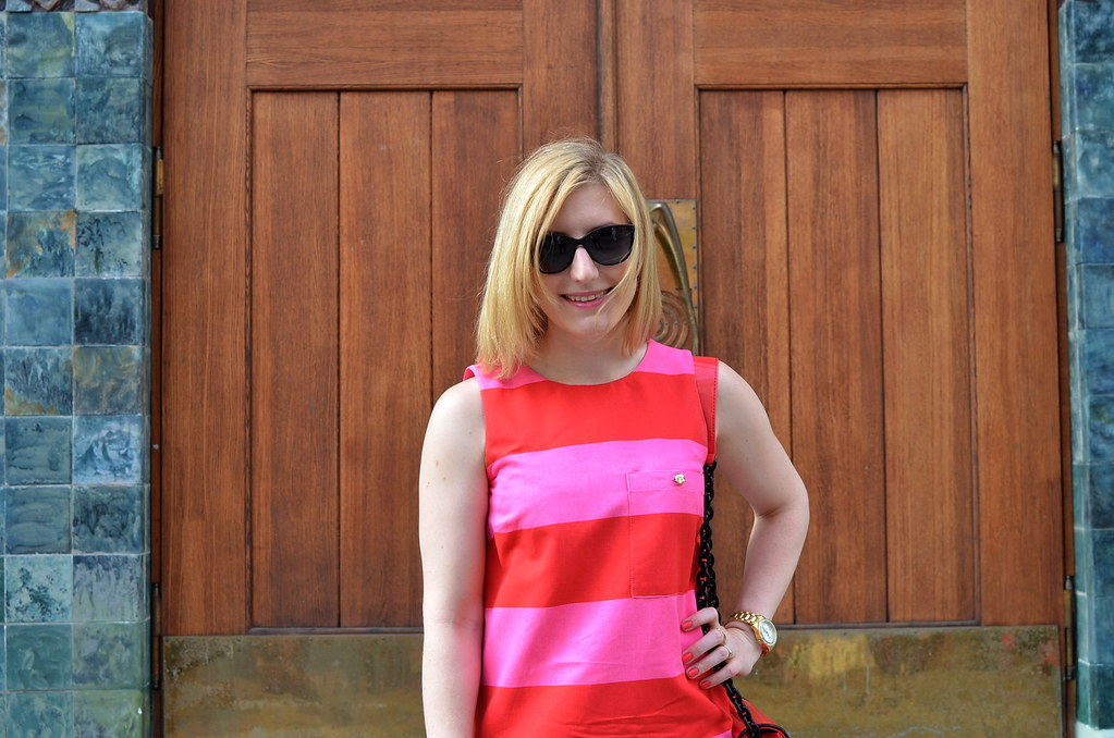 pink dress and black sunglasses