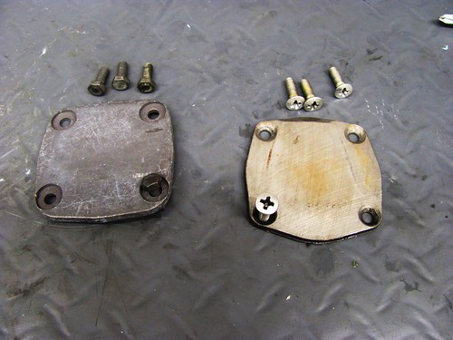 New Cover (Left) with 10 mm Bolts and Old with Philips Head Screws