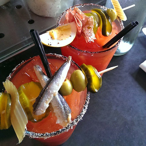 Viking Mary with aquavit & white anchovies on the left, Olympic Mary with salami swizzle on the right. #brunch #bloodymary #helpmeeee