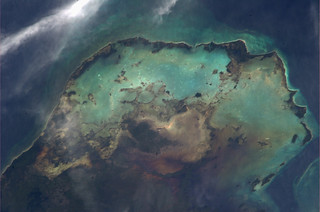 Sea, sand and clouds imitate a star forming nebula in the Caribbean