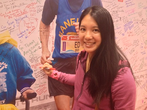 Signing the inspiration wall at the race expo.