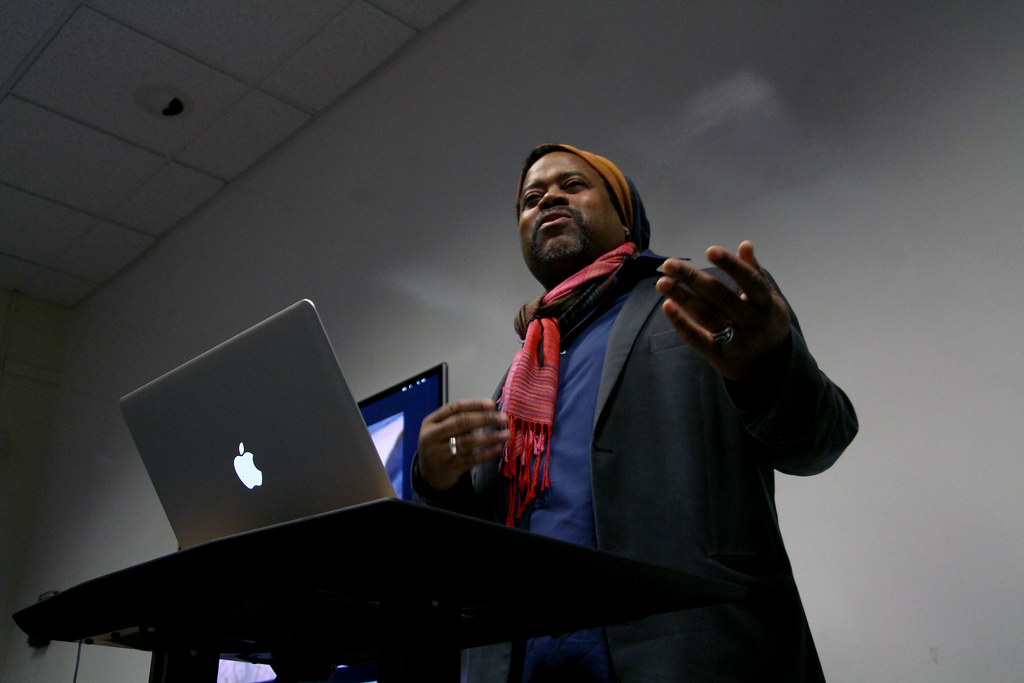 Greg Tate, a writer and musician, answers a student's question on the state of hip-hop at an event held by the Africana Studies department, on black arts and Afrofuturism, in SF State's Ethnic Studies and Psychology building, Monday, Feb. 17th, 2014. Photo by Gavin McIntyre / Xpress