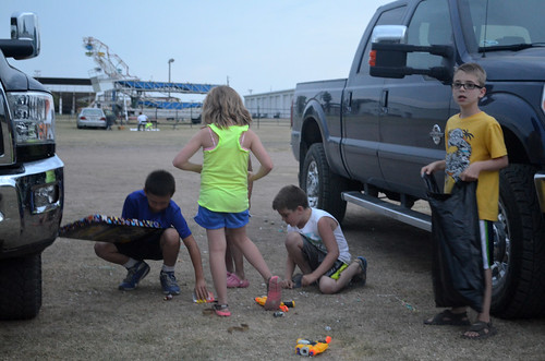 The kids pick up the confetti from their flameless fireworks
