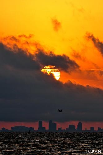 White Hot Sun Fights Dark Clouds On Amber Sky - IMRAN™ by ImranAnwar