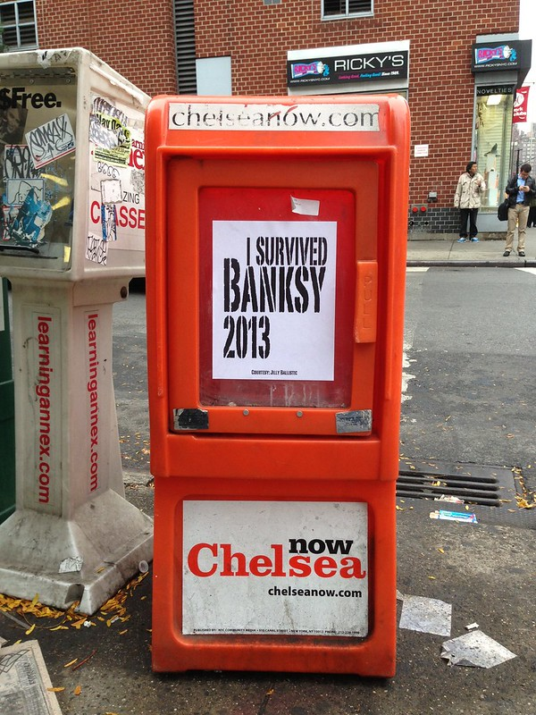 "I'm giving away 50 ""I survived Banksy 2013"" mini posters at the corner of 17th St and 8th Ave. First come, first served. Enjoy."