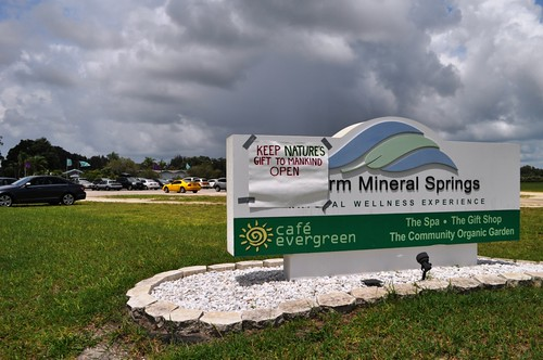 """Handmade sign reads, """"Keep Nature's Gift to Mankind Open,"""" on the Warm Mineral Springs sign, North Port, Fla., June 30, 2013."""