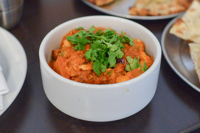 Chicken Tikka Masala chicken sauteed in a spicy tomato curry with diced onion and sweet peppers