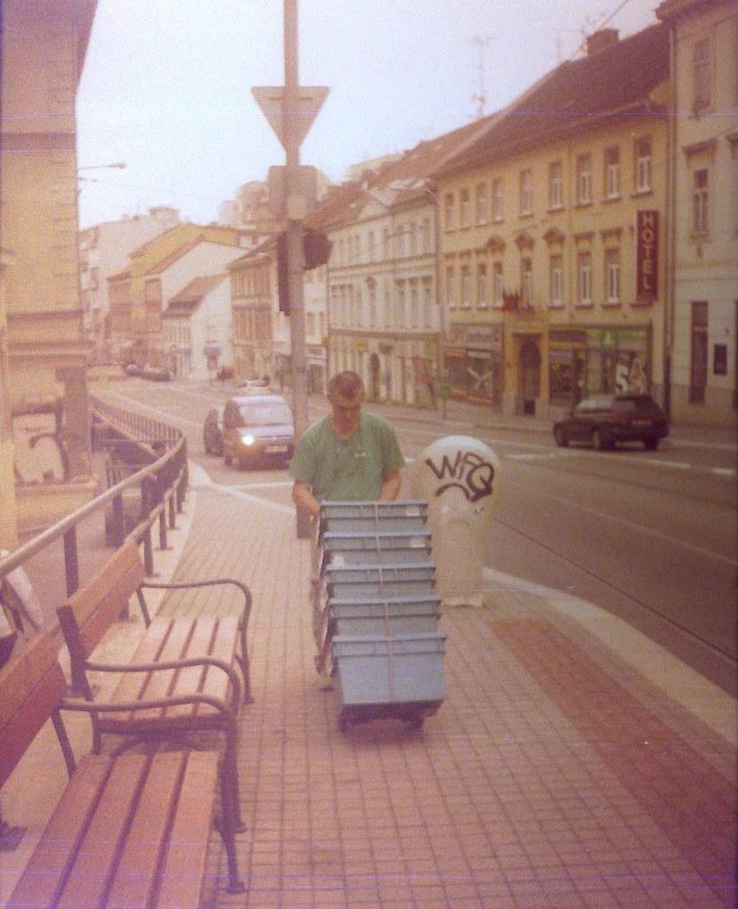 Chaika 3 (on redscale film) - Man with Boxes on Pekařská Street